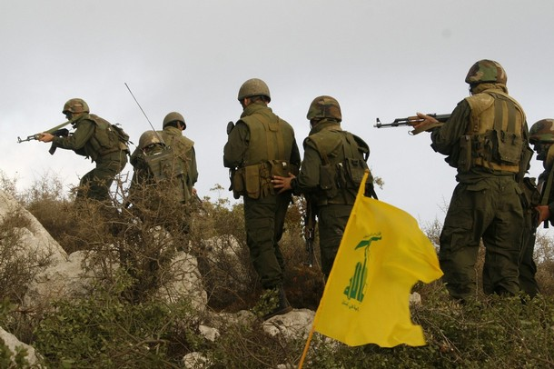 Group of Hezbollah fighters take position in Sujoud village in south Lebanon